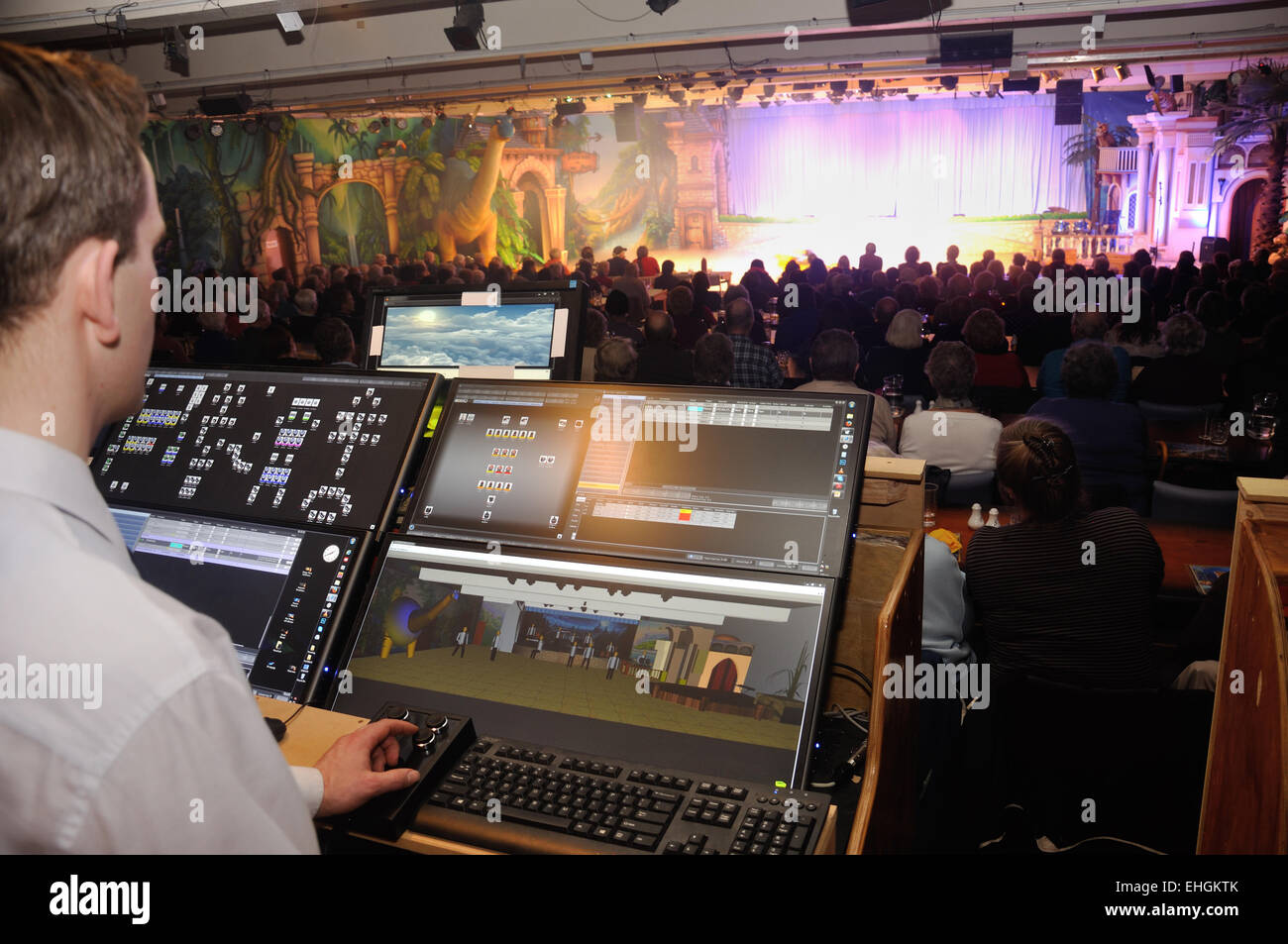 A lighting technician controls effects for a live stage performance - Stock Image