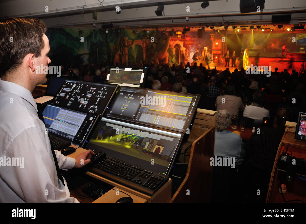 lighting technician. A Lighting Technician Controls Special Effects For Live Stage Performance