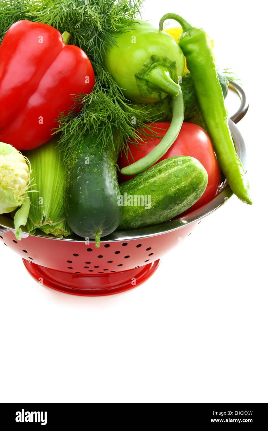 Fresh vegetables in metal colander. Stock Photo