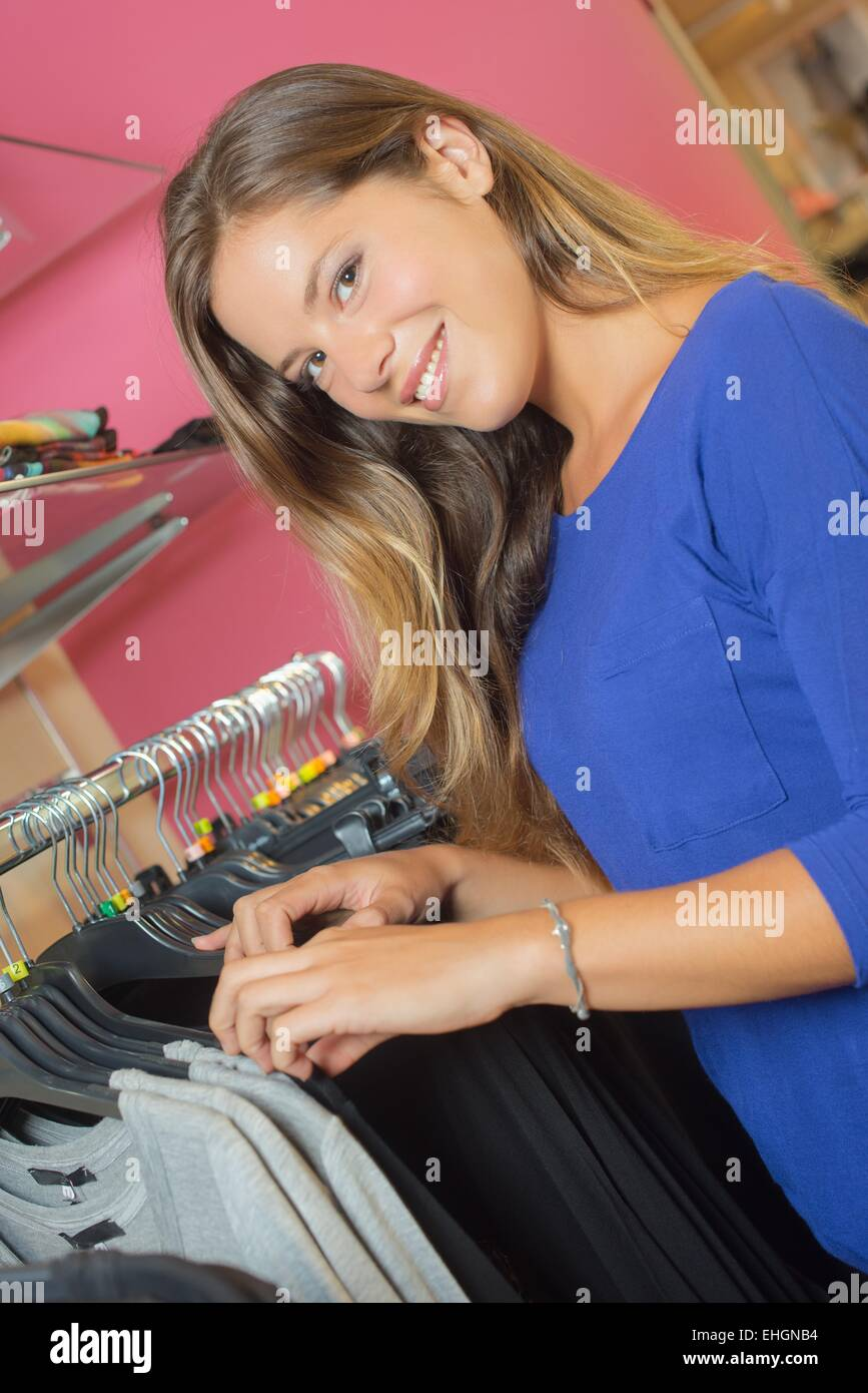 Woman trying out retail therapy - Stock Image