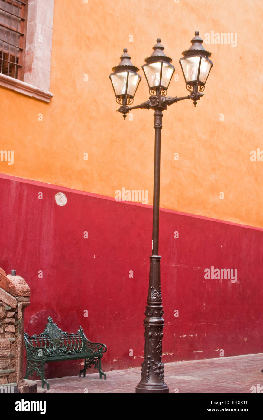 Lampost and bench Mexican streetscene - Stock Image
