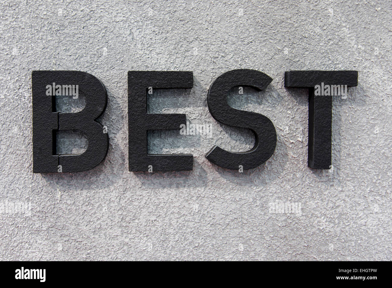 Best concept background, three dimensional black best text on the wall - Stock Image