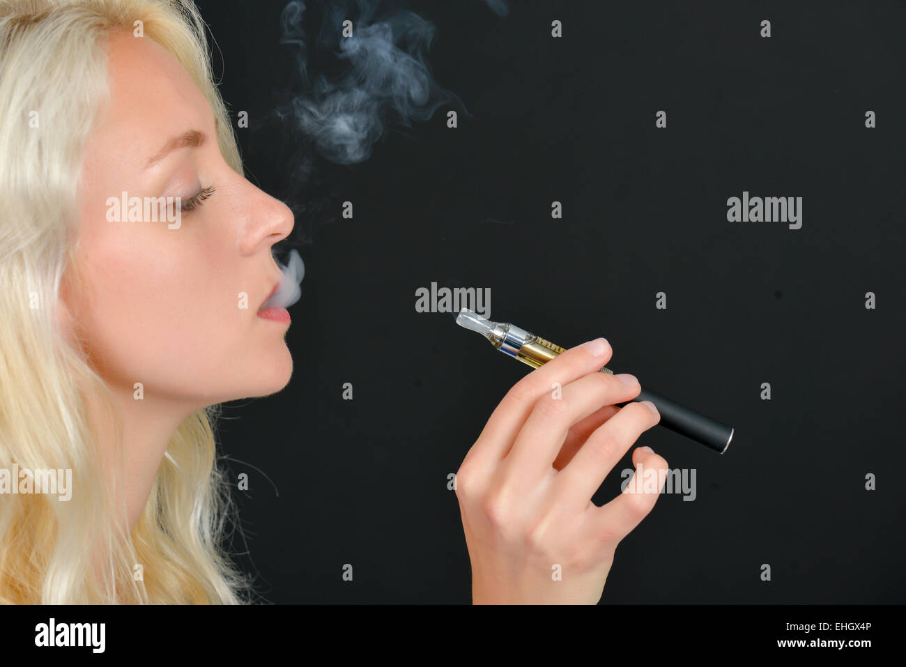 Taking a drag off an electric cigarette - Stock Image