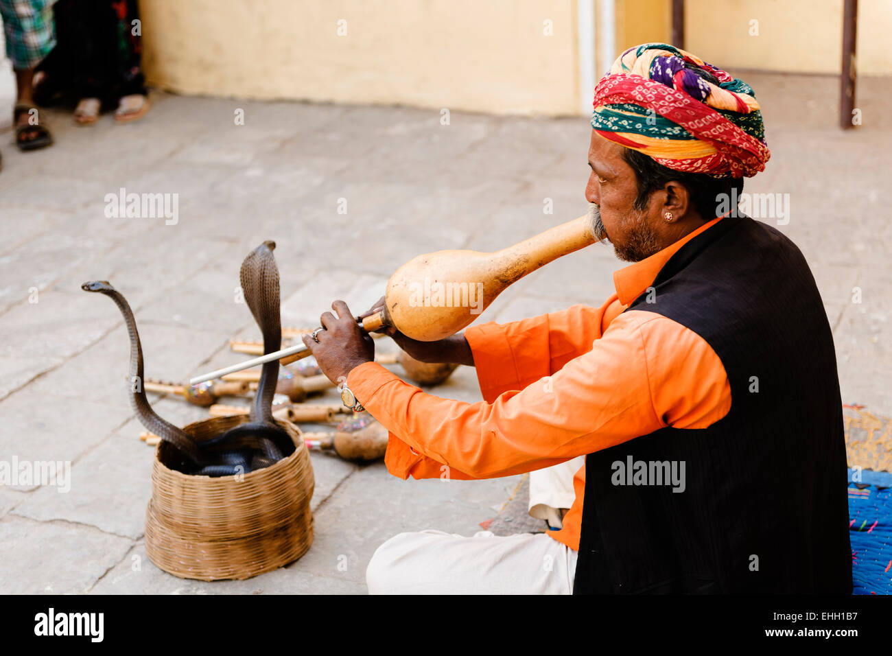 Snake charmer outside the Jaipur City Palace and Museum. Stock Photo