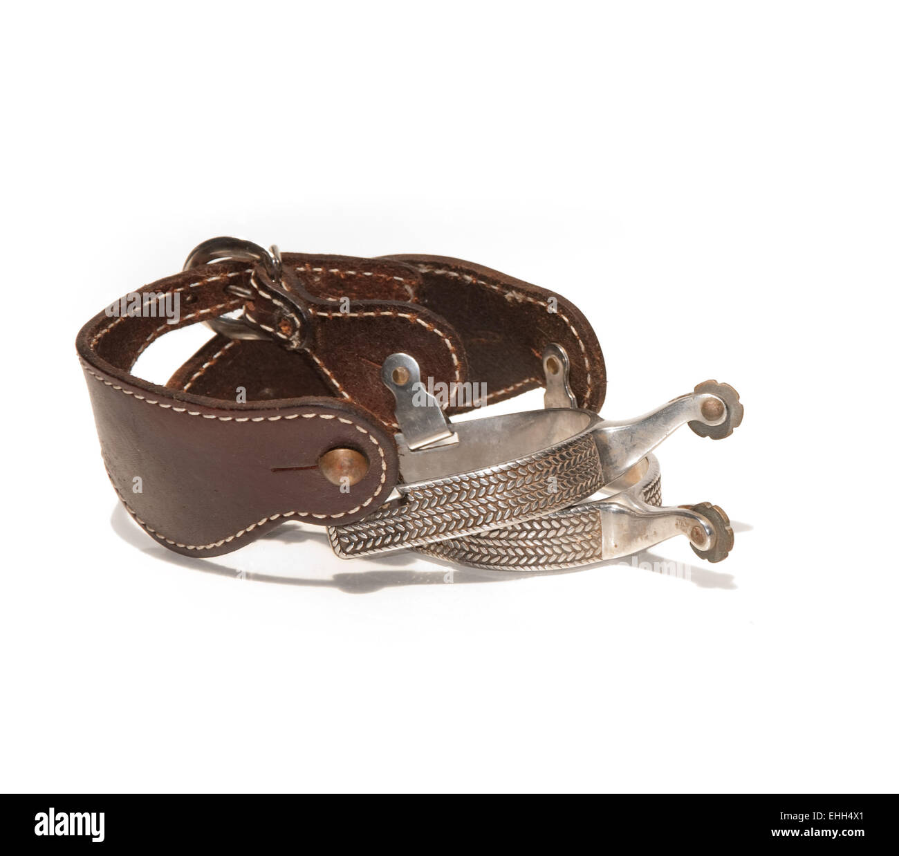 Western silver spurs on white - Stock Image