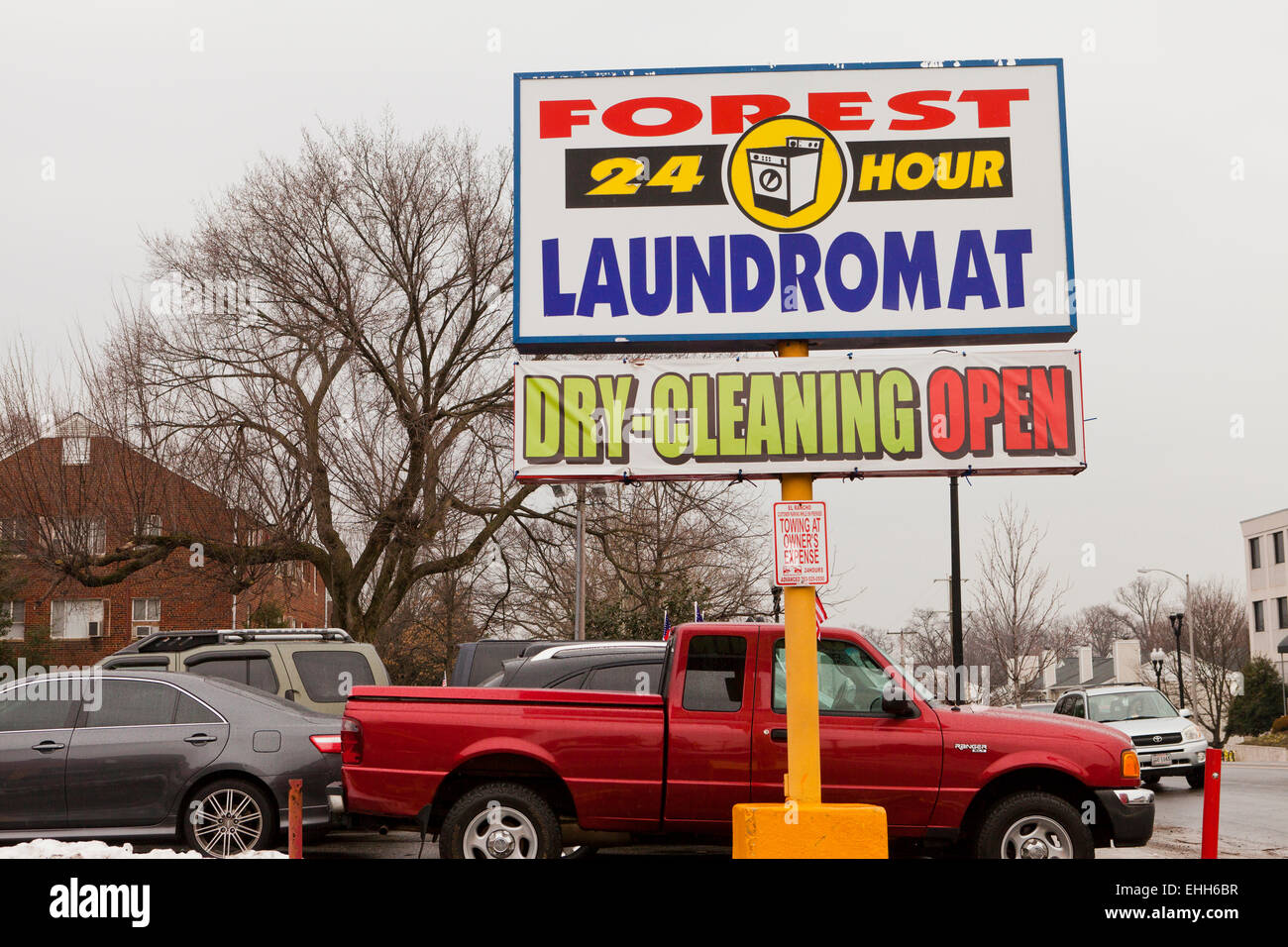24 hour Laundromat sign - USA - Stock Image