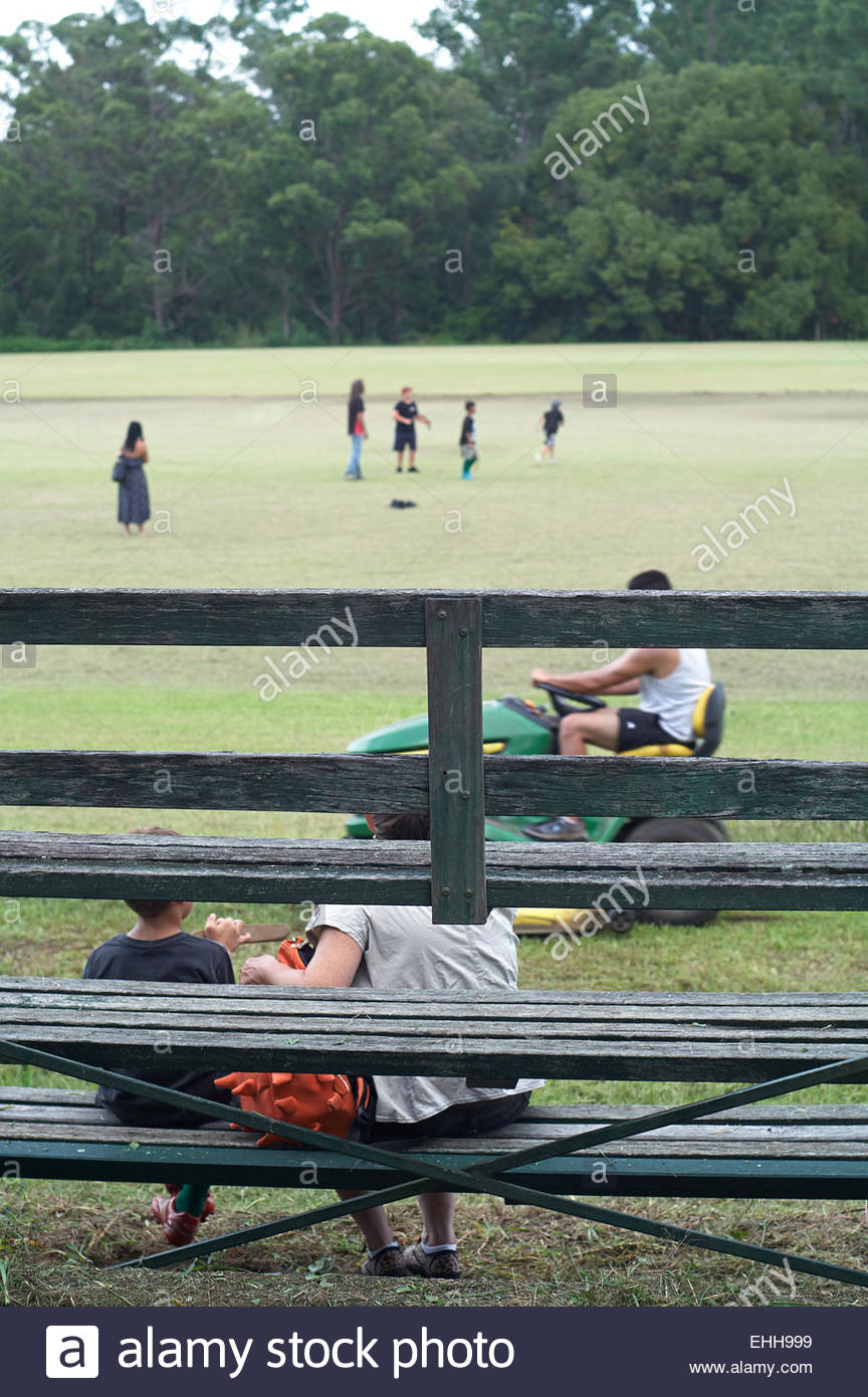 people doing jobs, at a working bee for the local soccer club in nimbin, nsw, australia - Stock Image