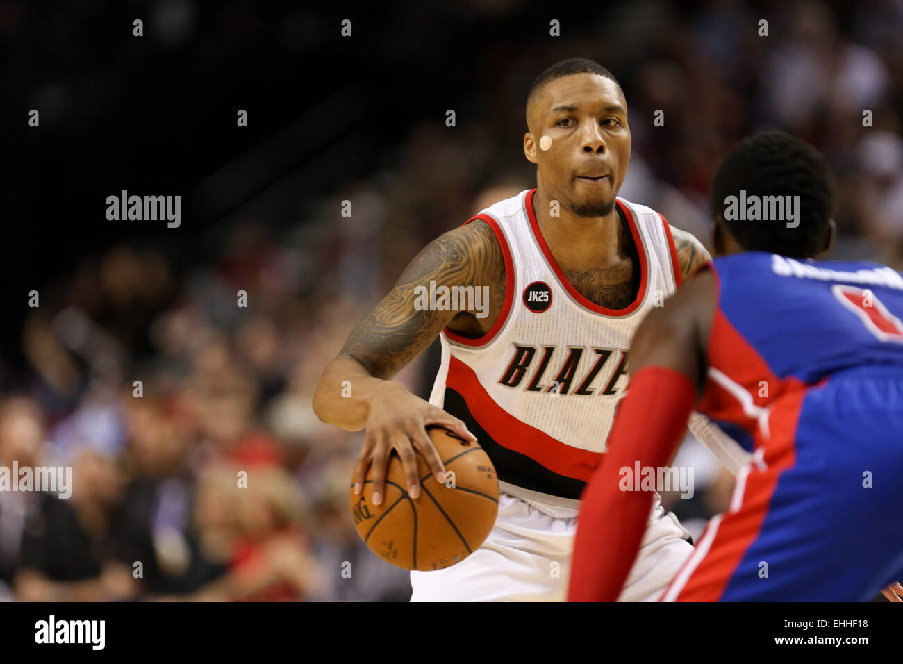 March 13, 2015 - DAMIAN LILLARD (0) looks to pass. The Portland Trail Blazers play the Detroit Pistons at the Moda Stock Photo