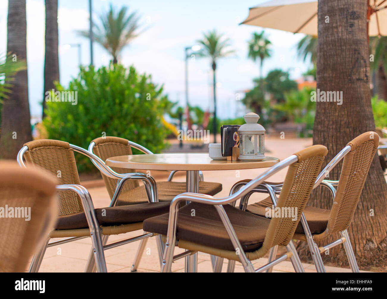 Mediterranean Cafe Terrace Exterior With Chairs.