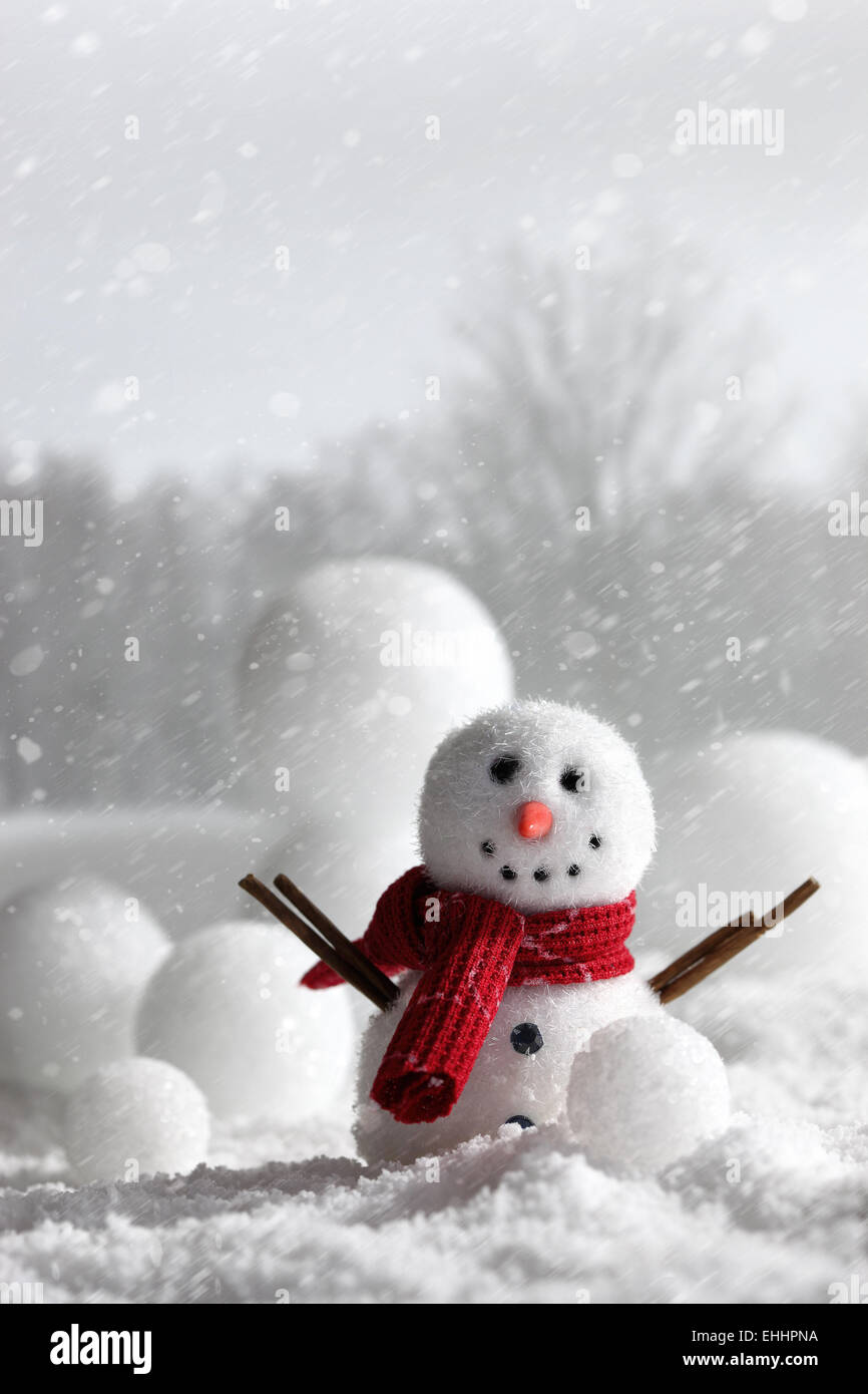 Snowman with wintery background - Stock Image