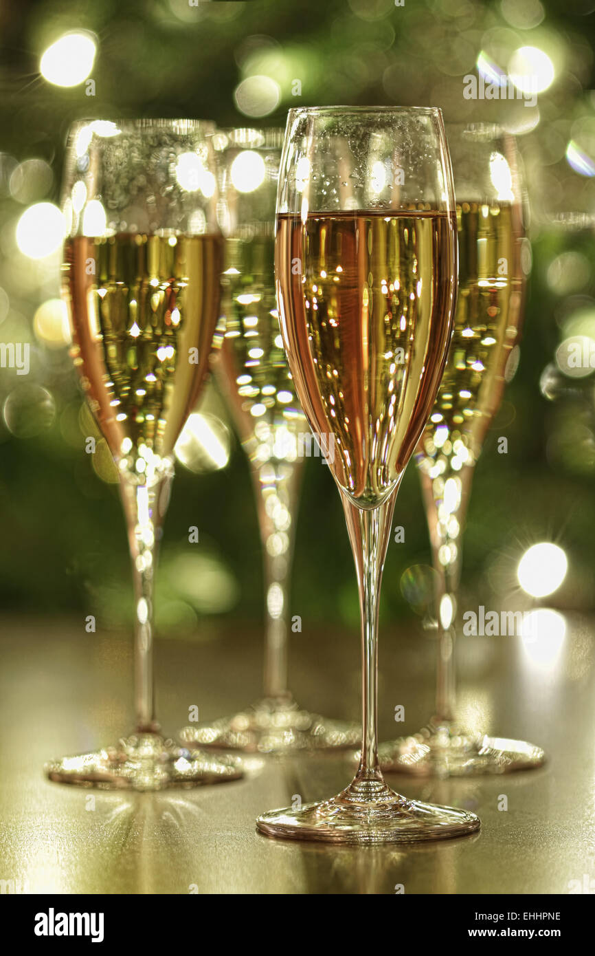 Glasses of champagne sparkle - Stock Image