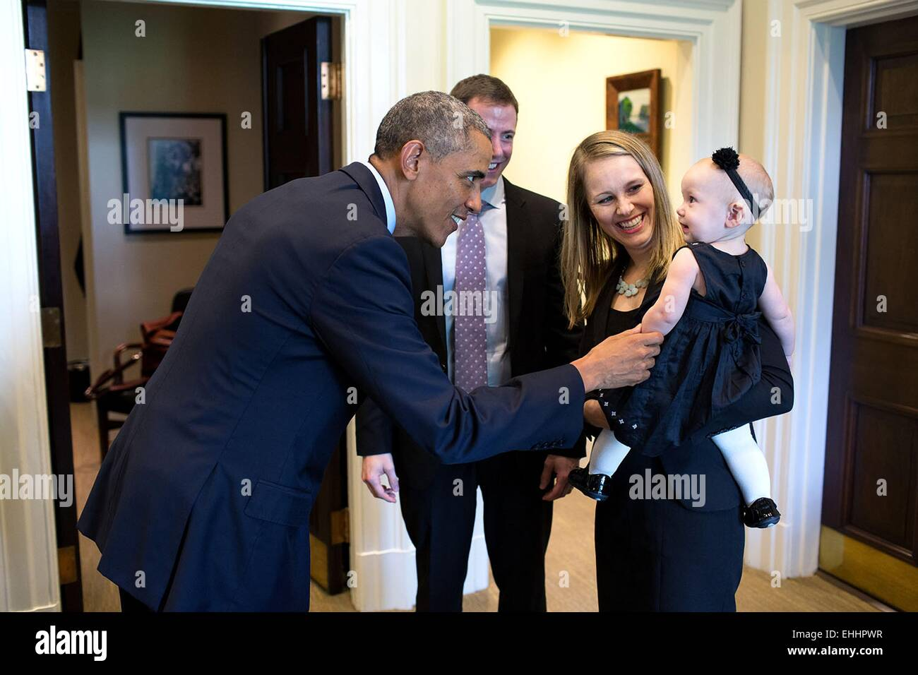 US President Barack Obama greets departing staff member Lindsay Hayes and family in the Outer Oval Office September - Stock Image