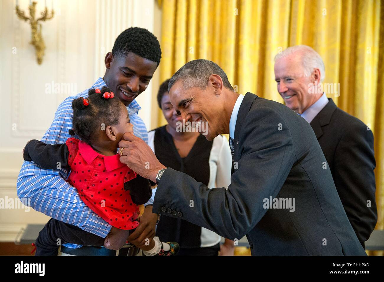 Us president barack obama greets a little girl as he and vice stock us president barack obama greets a little girl as he and vice president joe biden meet with wounded warriors and their families in the east room during a m4hsunfo Image collections