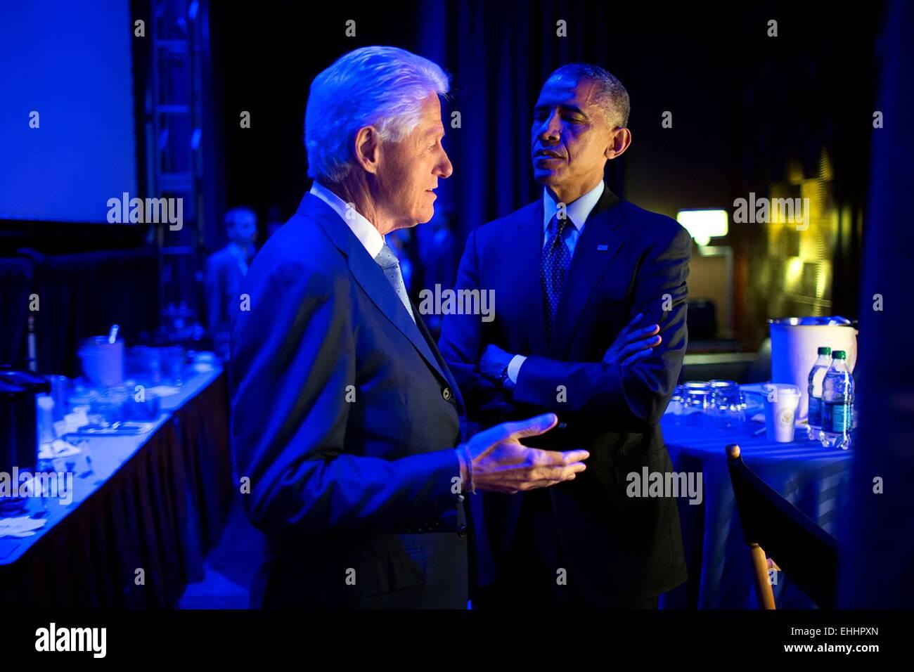 US President Barack Obama speaks with former President Bill Clinton backstage prior to delivering remarks during - Stock Image