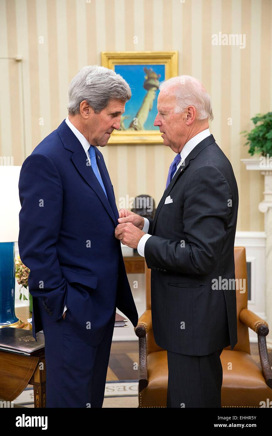 US Vice President Joe Biden talks with Secretary of State John Kerry in the Oval Office of the White House October - Stock Image