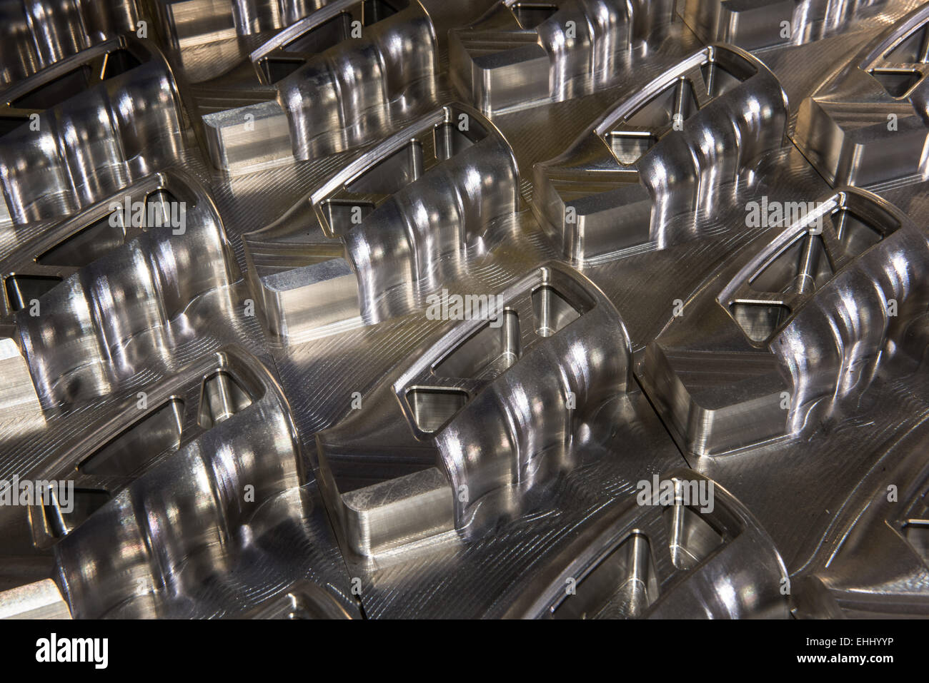 Partly machined aluminum rifle grips seen in the workshop of Jesse James Firearms Unlimited near Dripping Springs, Stock Photo