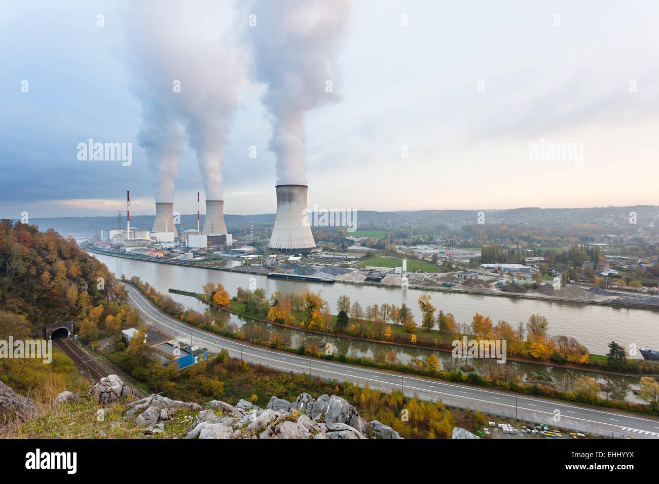 A large nuclear power station by a river in the evening - Stock Image