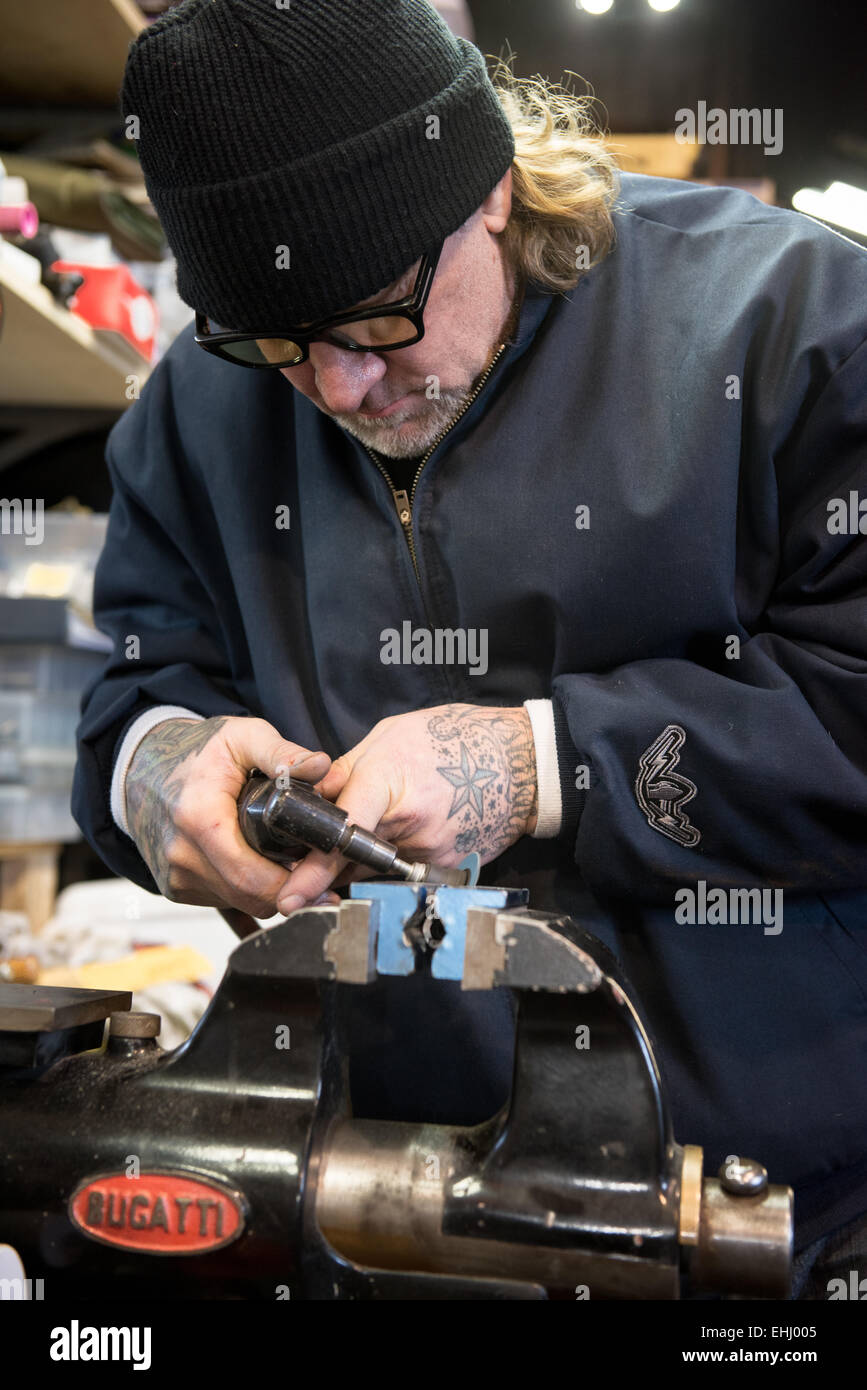 Mechanic, engineer, TV celebrity and gun maker Jesse James at work in his workshop near Dripping Springs, Texas, Stock Photo