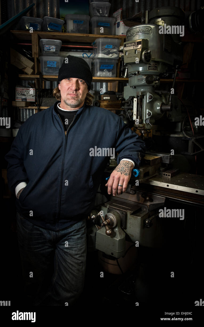 Mechanic, engineer, TV celebrity and gun maker Jesse James at his workshop near Dripping Springs, Texas, USA Stock Photo