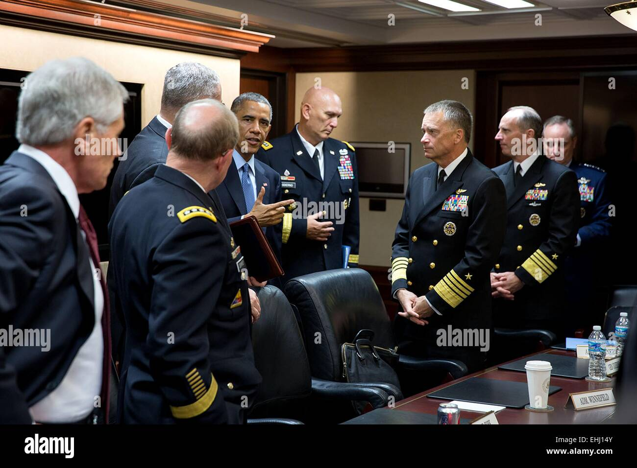 US President Barack Obama talks with the Joint Chiefs of Staff following a meeting in the Situation Room of the - Stock Image