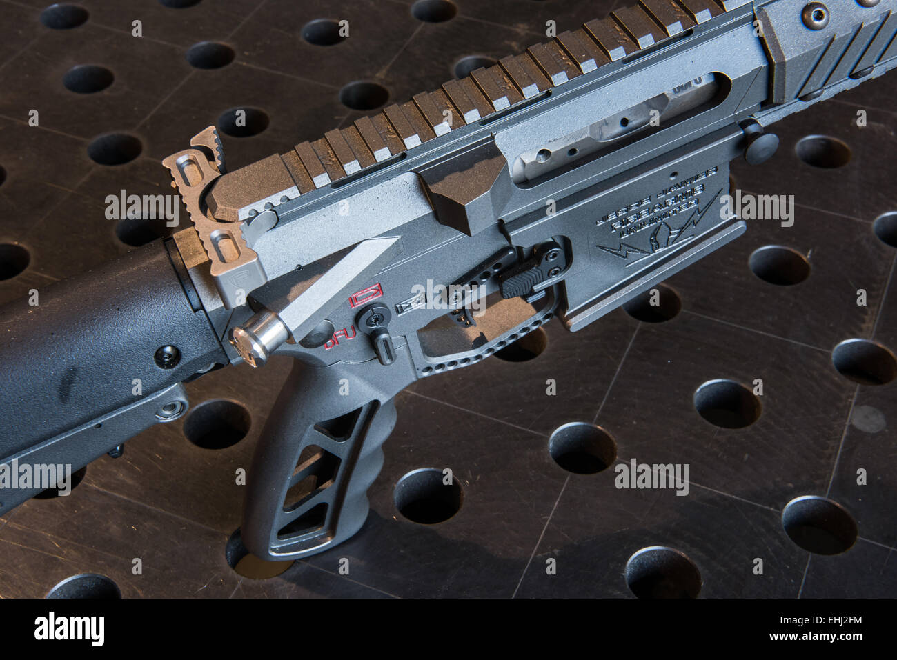 The grip and trigger of an assault rifle manufactured by Jesse James Firearms Unlimited of Dripping Springs, Texas, Stock Photo
