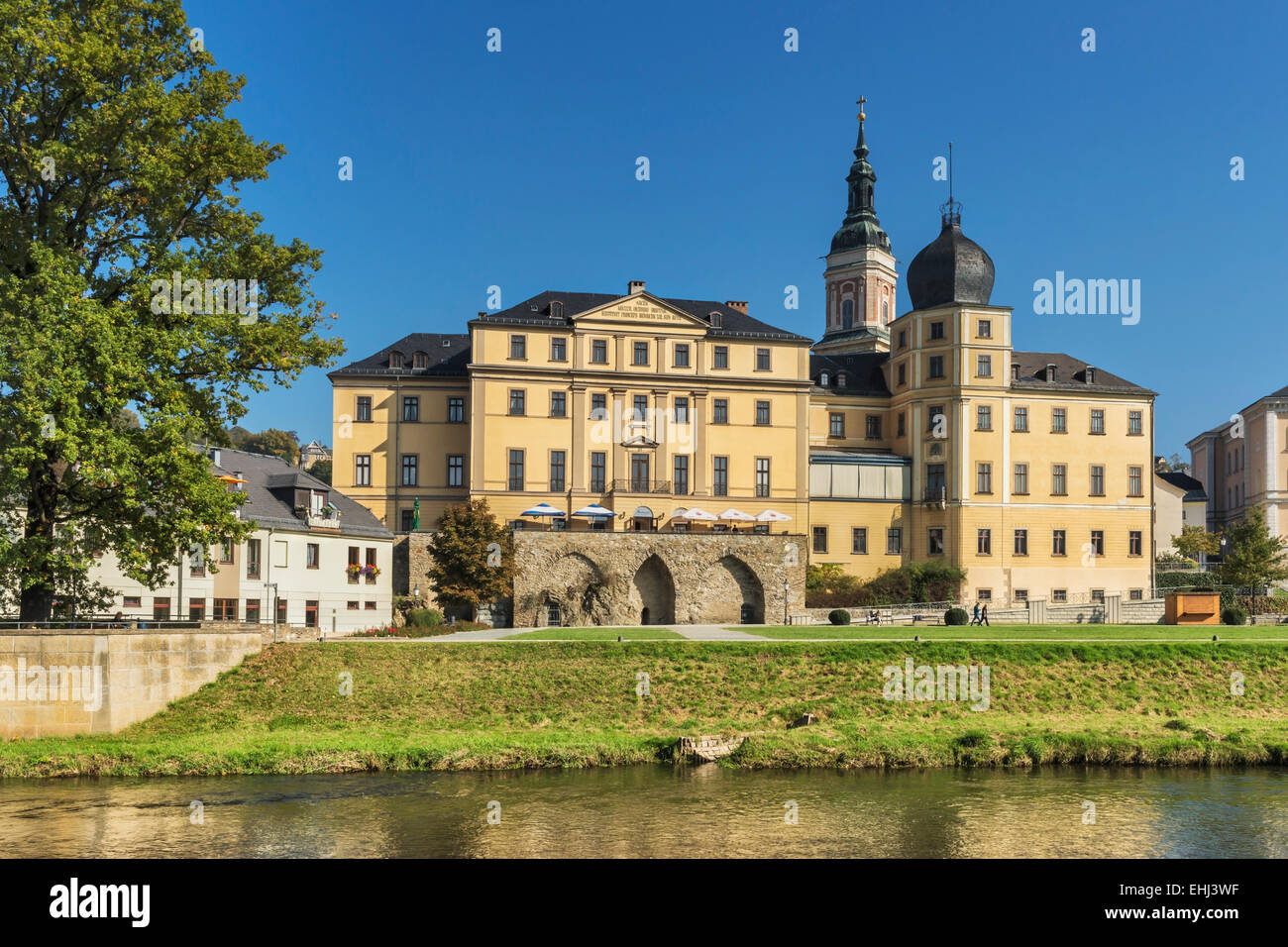 The Lower Castle is situated on the banks of the White Elster, next to the St. Marys Church, Greiz, Thuringia, Germany, - Stock Image