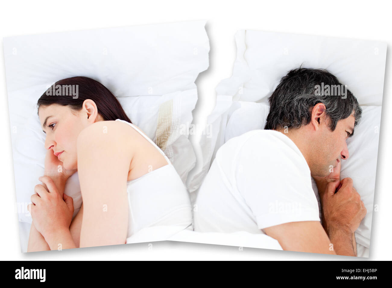 Couple turned away from each other in bed Stock Photo