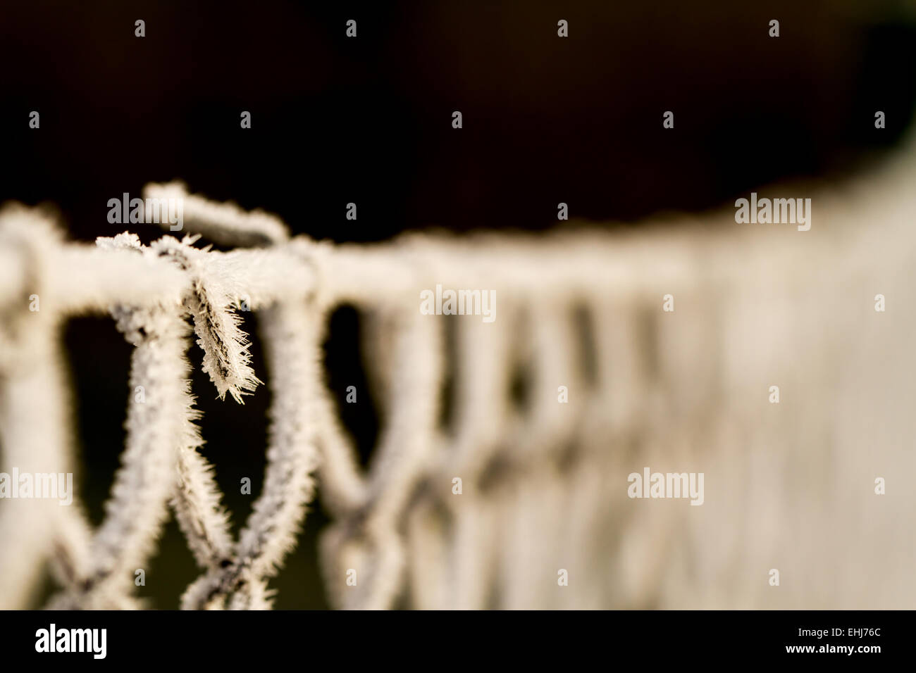 wire fence texture with hoarfrost overlay - Stock Image