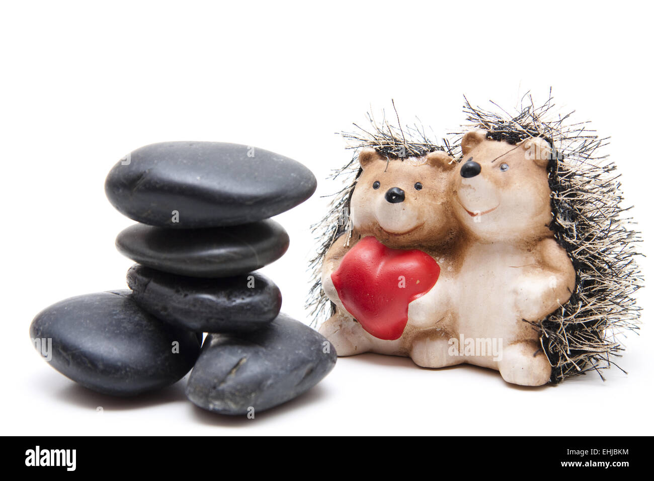 Stones with hedgehog pair and heart - Stock Image