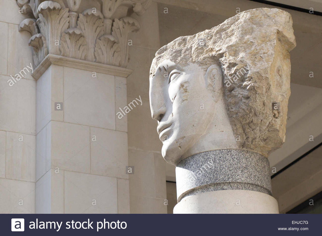 Stone head sculpture near St Paul's Cathedral London - Stock Image