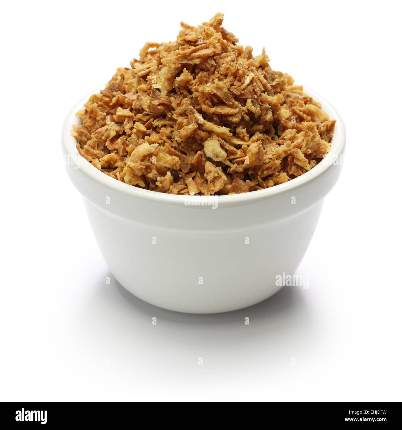 crispy fried onion flakes on white background - Stock Image
