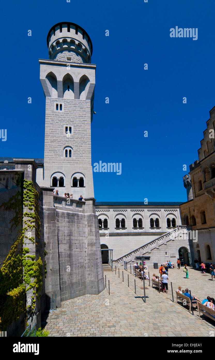 Fairy tales castle with tower in the blue sky - Stock Image