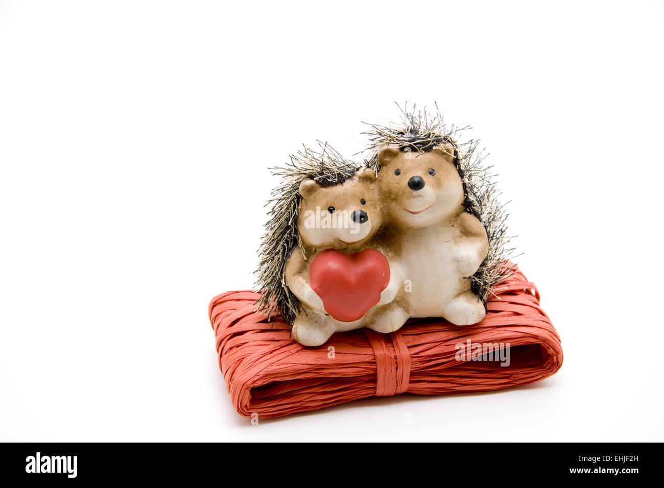 Hedgehog pair on gift loop - Stock Image