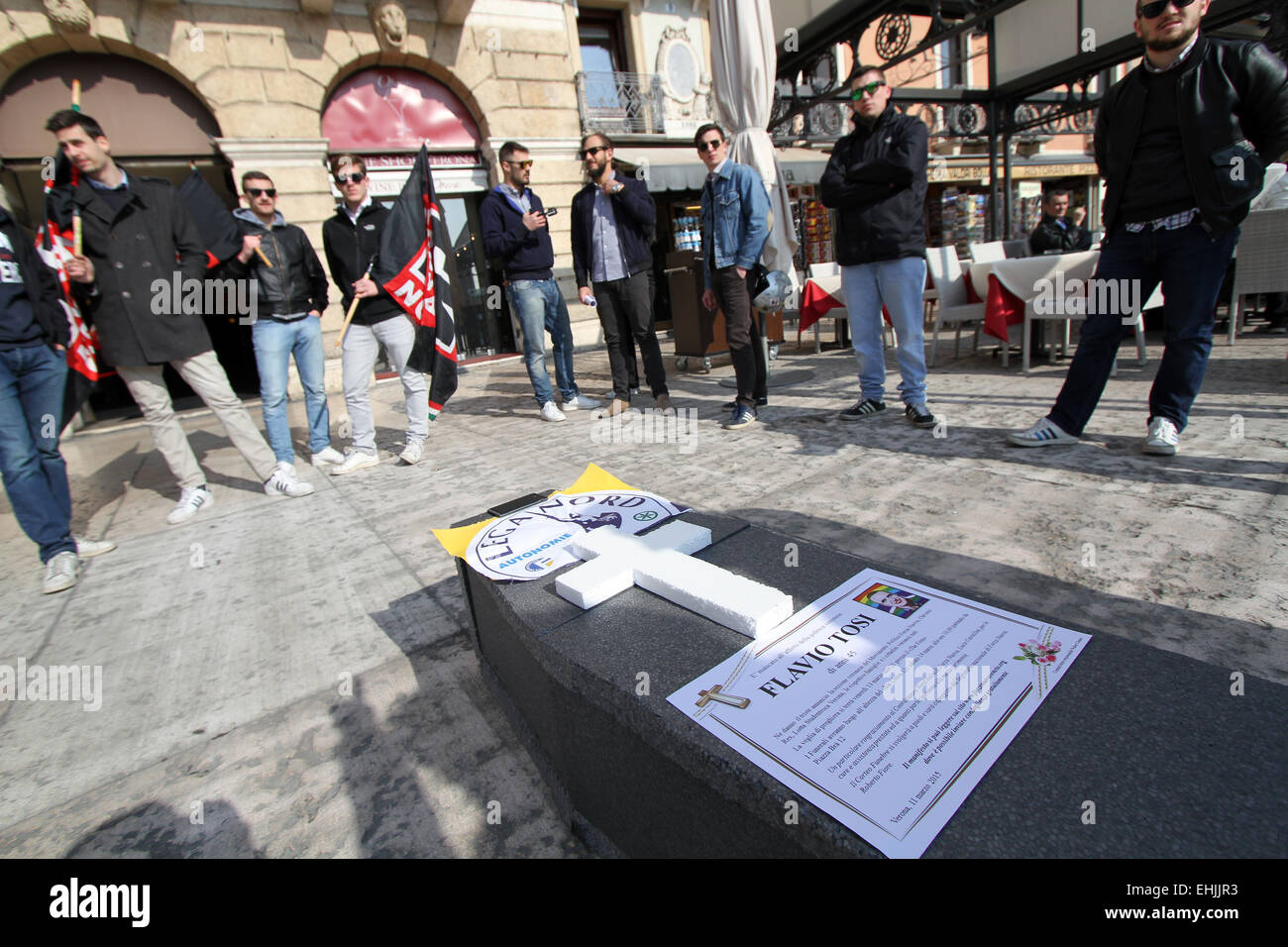 Verona, Italy. 14th Mar, 2015. Italian Political Party Forza Nuova shows a fake funeral ceremony with coffin made Stock Photo