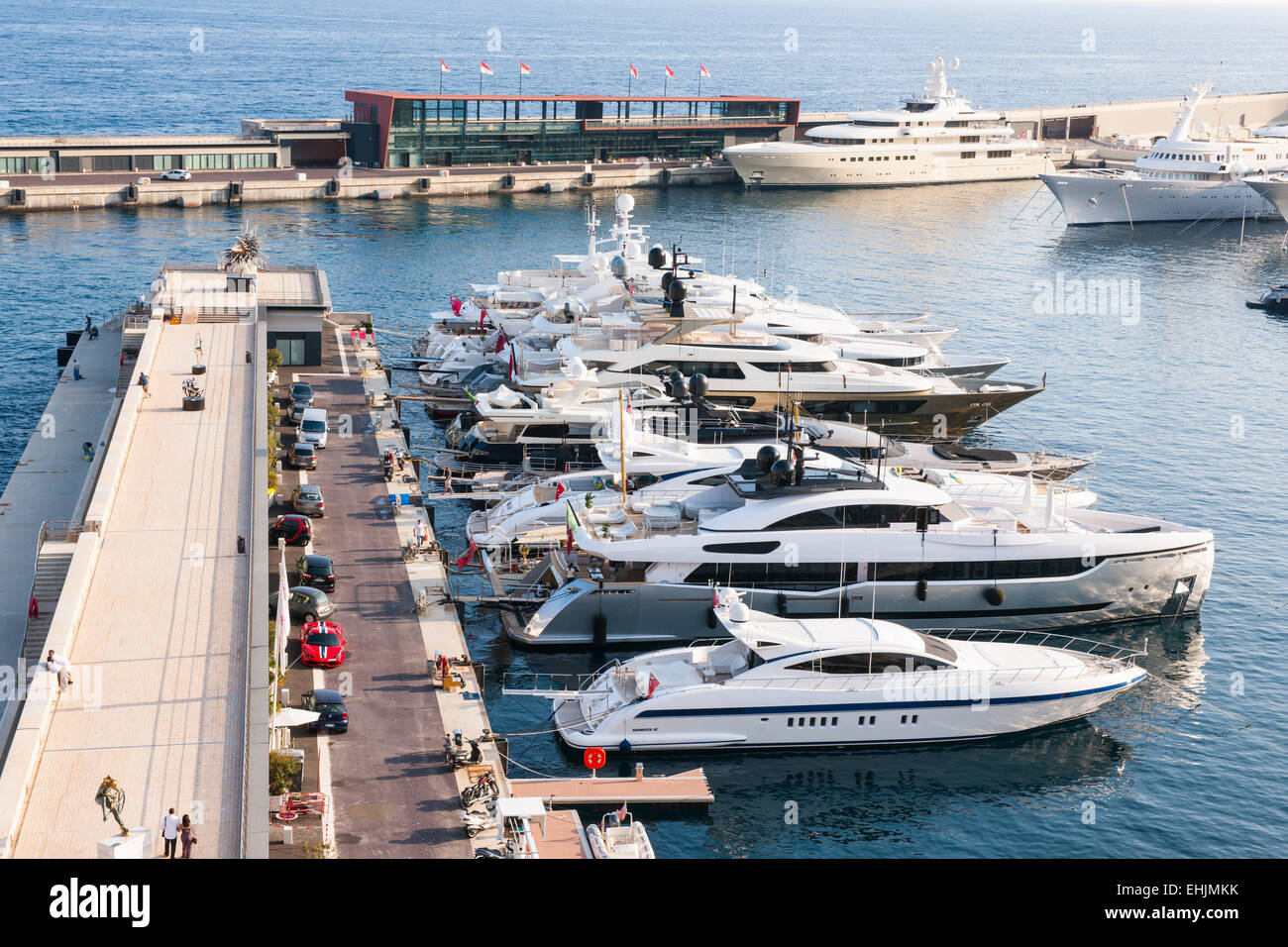 MONTE CARLO, MONACO - OCTOBER 3, 2014: Luxury yachts docked at pier of port Hercule in Monaco viewed from seaside - Stock Image
