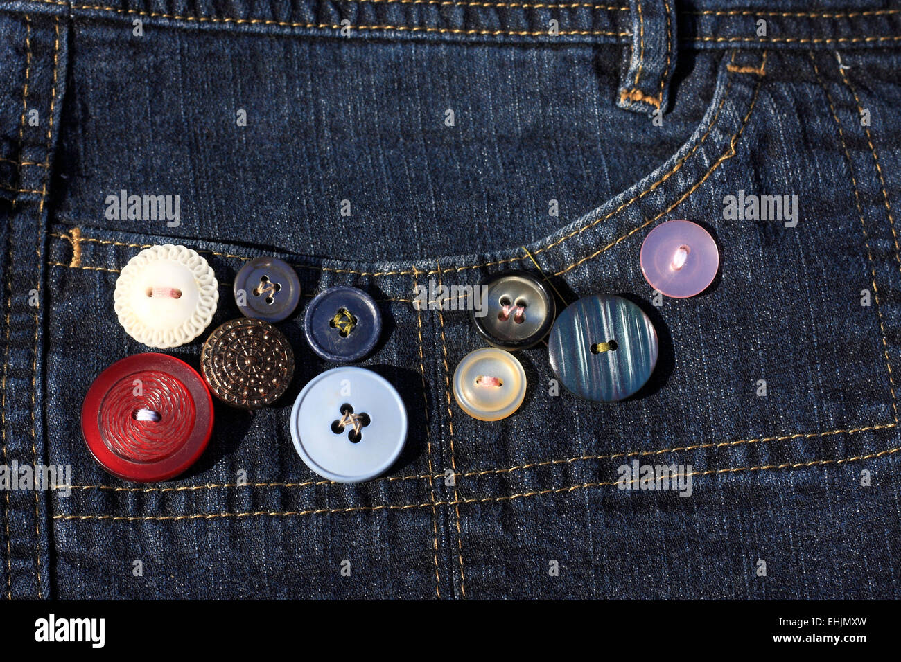 Diverse buttons on the jeans - Stock Image
