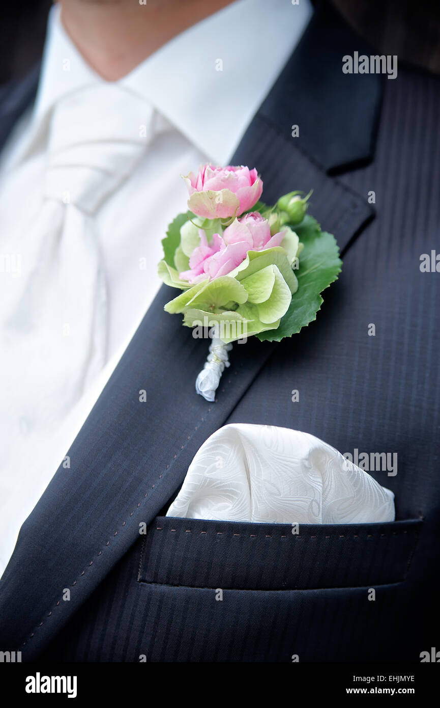 Flower on a Tux of a Groom - Stock Image