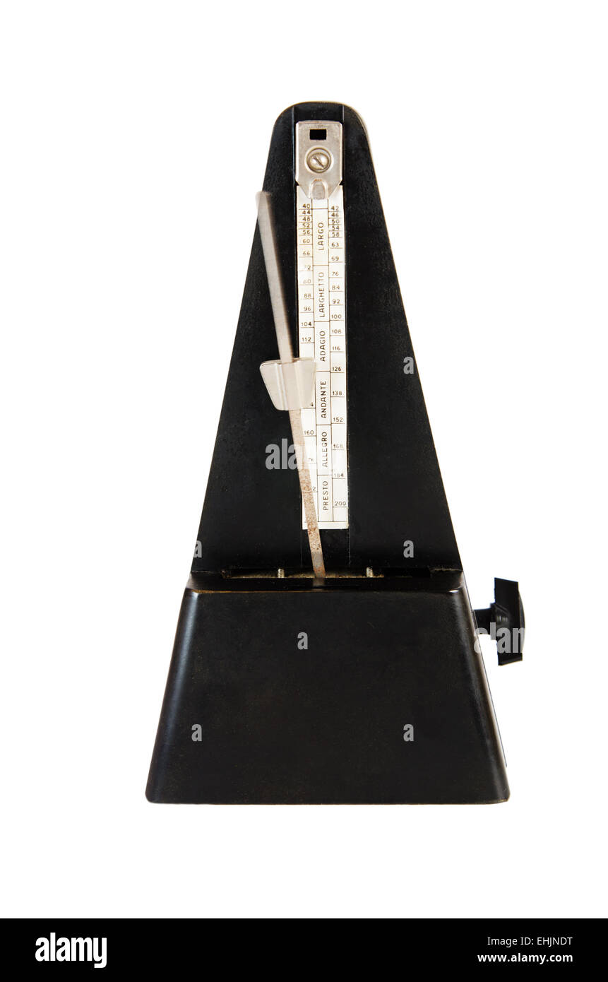 Old metronome it is isolated on white - Stock Image