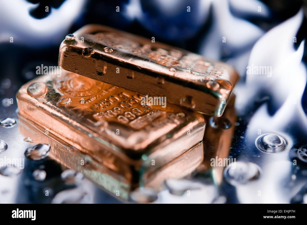 gold ingot and  flame - Stock Image