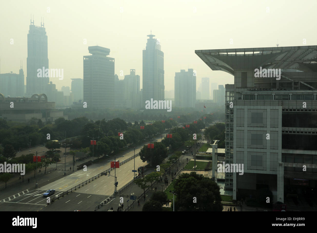 The view of People's Square in a smoggy day with Shanghai Urban Planning Exhibition Center in foreground. Shanghai, Stock Photo