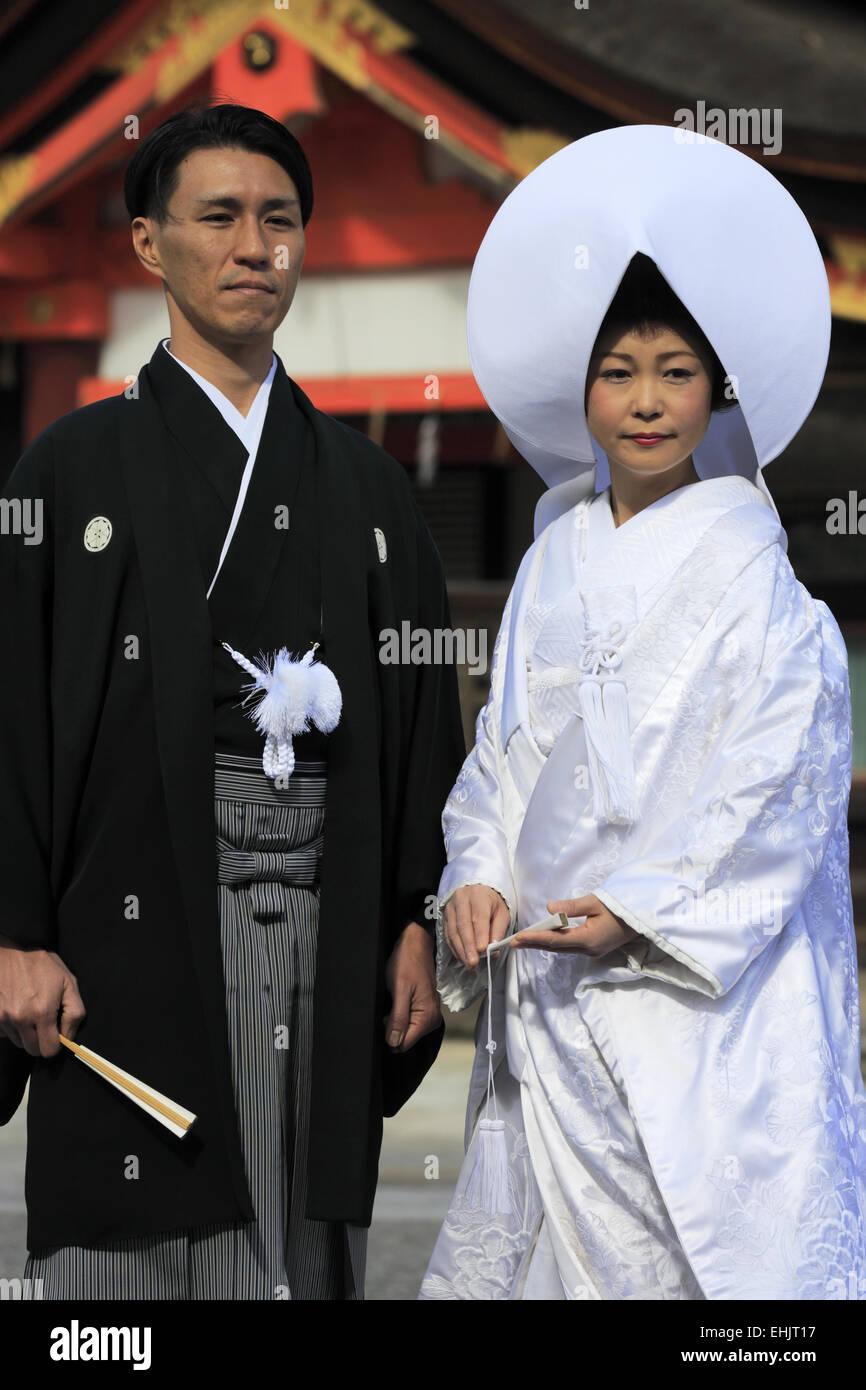 Traditional Japanese Wedding.A Japanese Couple In Traditional Japanese Wedding Kimono Posing For