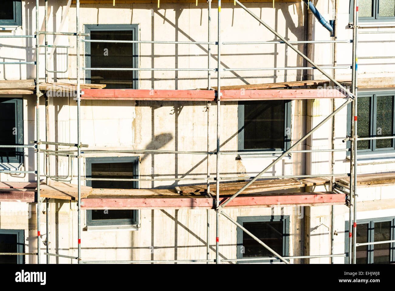Construction of new house with scaffolding - Stock Image