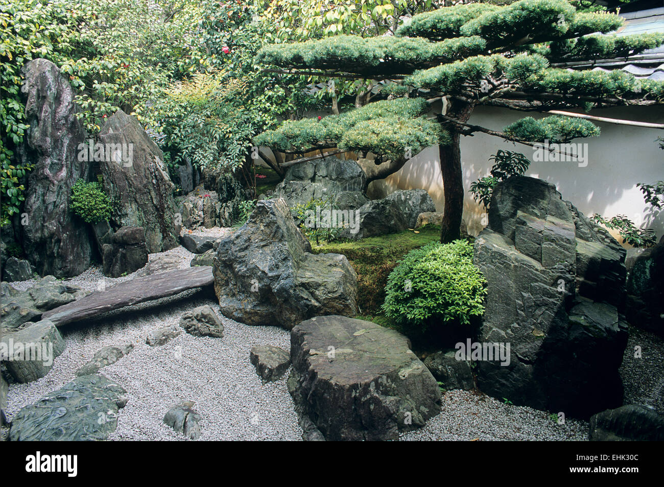 This Zen garden landscape of stones, pines and a dry stream is one of the most famous Japanese garden arramngements - Stock Image
