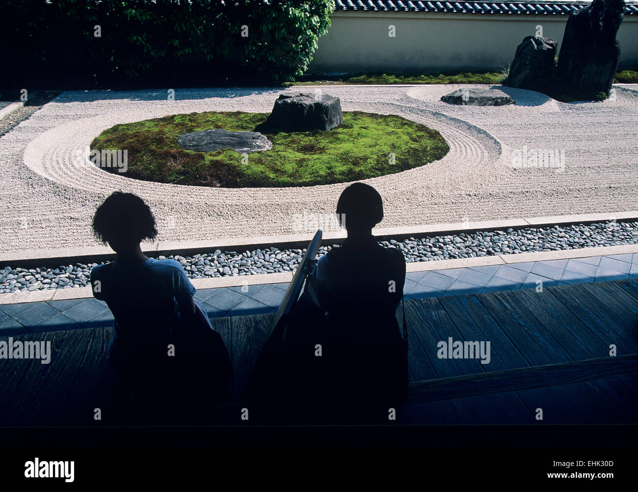 The simple garden at the Ryogen-in sub temple at the Daitoku-ji complex provides visitors with a sense of the Zen - Stock Image