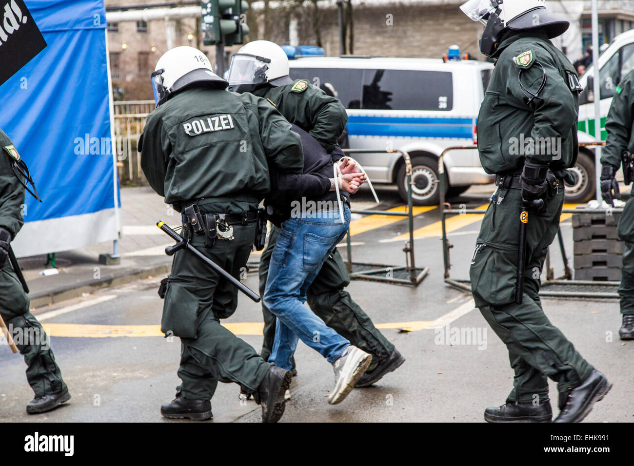 Demonstration of right wing PEGIDA organization, together with violent Hooligans, against a meeting of Islamic Salafist - Stock Image