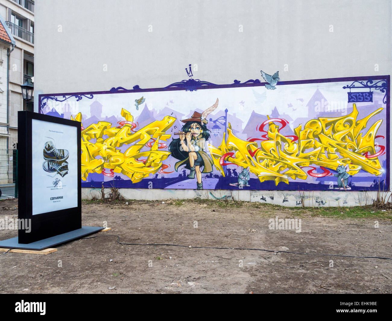 ccbcf537d9f1 Berlin  Pied Piper of Hamelin  street art mural and Converse Trainers  Advertisement