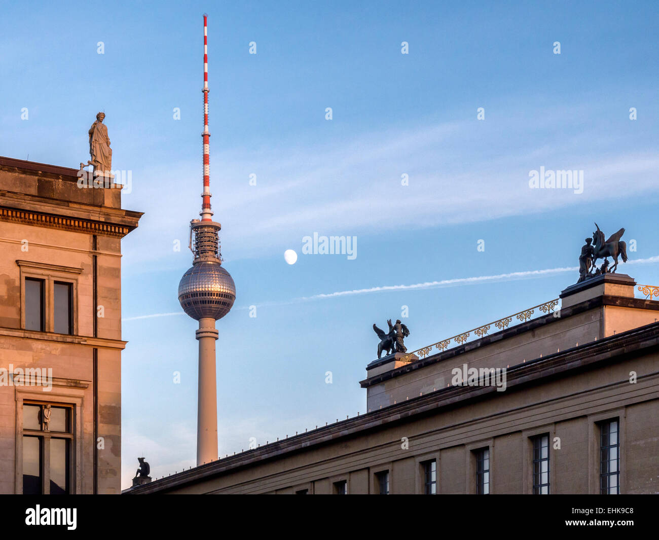 Museum Island buildings, TV tower, rooftop sculptures, moon and blue sky - Museum insel, Mitte, Berlin - Stock Image