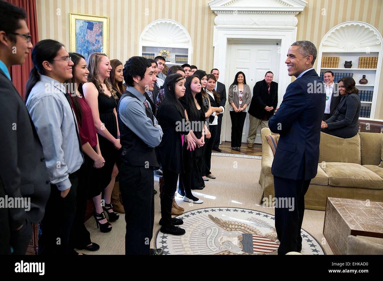 US President Barack Obama talks with youth from the Standing Rock Sioux Tribe in the Oval Office of the White House - Stock Image