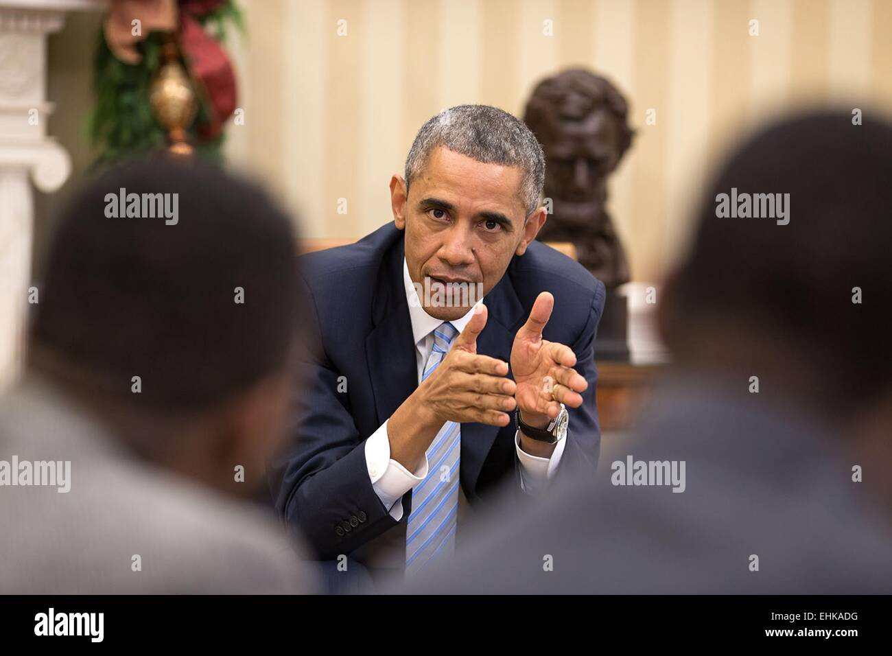 US President Barack Obama meets with young local and national civil rights leaders in the Oval Office of the White - Stock Image