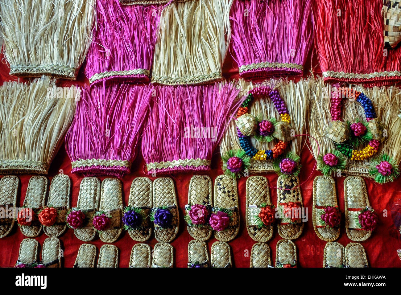 Souvenir grass skirts, garlands and woven shoes. Fiji. Pacific - Stock Image